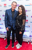 Radio personality Elvis Duran and Singer/songwriter Alessia Cara attend Q102's Jingle Ball 2015 presented by Capital One at Wells Fargo Center on...