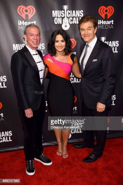 Radio Personality Elvis Duran Singer Demi Lovato and Dr Mehmet Oz attend A Night To Celebrate Elvis Duran presented by Musicians On Call at The...