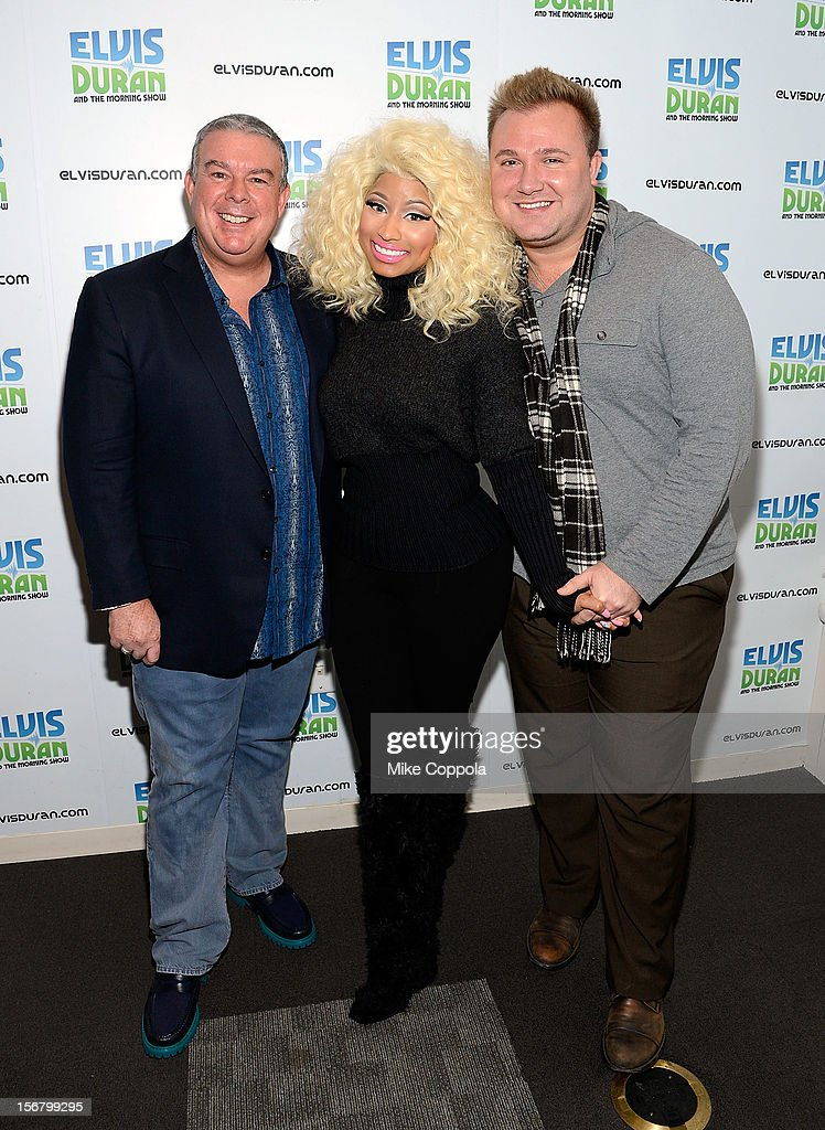 Radio personality <a gi-track='captionPersonalityLinkClicked' href=/galleries/search?phrase=Elvis+Duran&family=editorial&specificpeople=3048281 ng-click='$event.stopPropagation()'>Elvis Duran</a>, singer <a gi-track='captionPersonalityLinkClicked' href=/galleries/search?phrase=Nicki+Minaj+-+Artista&family=editorial&specificpeople=6362705 ng-click='$event.stopPropagation()'>Nicki Minaj</a>, and publicist Steven Levine pose for a picture at Z100 Studio on November 21, 2012 in New York City.
