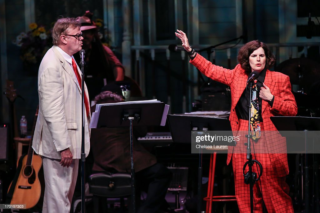 Radio personality <a gi-track='captionPersonalityLinkClicked' href=/galleries/search?phrase=Garrison+Keillor&family=editorial&specificpeople=594099 ng-click='$event.stopPropagation()'>Garrison Keillor</a> (L) and comedienne <a gi-track='captionPersonalityLinkClicked' href=/galleries/search?phrase=Paula+Poundstone&family=editorial&specificpeople=1018199 ng-click='$event.stopPropagation()'>Paula Poundstone</a> perform during A Prairie Home Companion taping at The Greek Theatre on June 7, 2013 in Los Angeles, California.