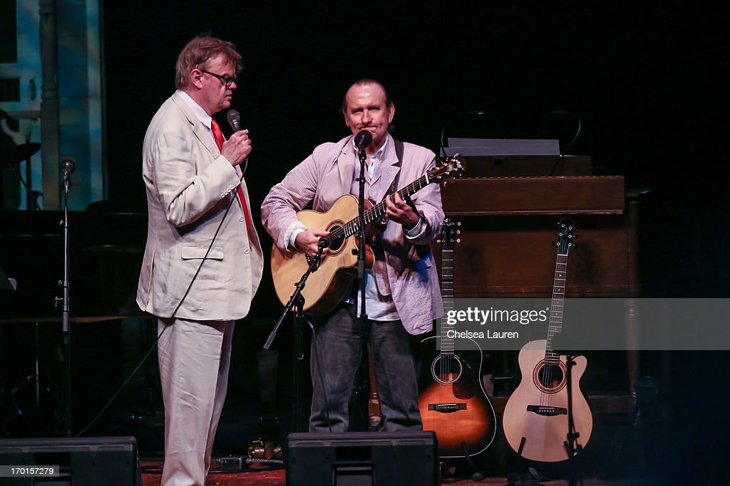 Radio personality <a gi-track='captionPersonalityLinkClicked' href=/galleries/search?phrase=Garrison+Keillor&family=editorial&specificpeople=594099 ng-click='$event.stopPropagation()'>Garrison Keillor</a> (L) and musician <a gi-track='captionPersonalityLinkClicked' href=/galleries/search?phrase=Colin+Hay&family=editorial&specificpeople=1953993 ng-click='$event.stopPropagation()'>Colin Hay</a> perform during A Prairie Home Companion taping at The Greek Theatre on June 7, 2013 in Los Angeles, California.