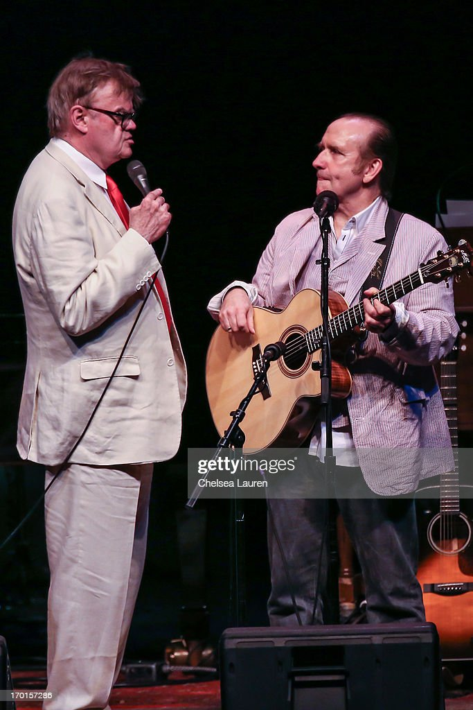 Radio personality Garrison Keillor (L) and musician Colin Hay perform during A Prairie Home Companion taping at The Greek Theatre on June 7, 2013 in Los Angeles, California.