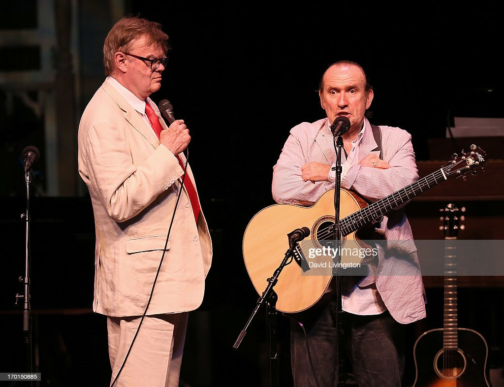 Radio personality Garrison Keillor (L) and recording artist Colin Hay perform on stage at the Greek Theatre on June 7, 2013 in Los Angeles, California.