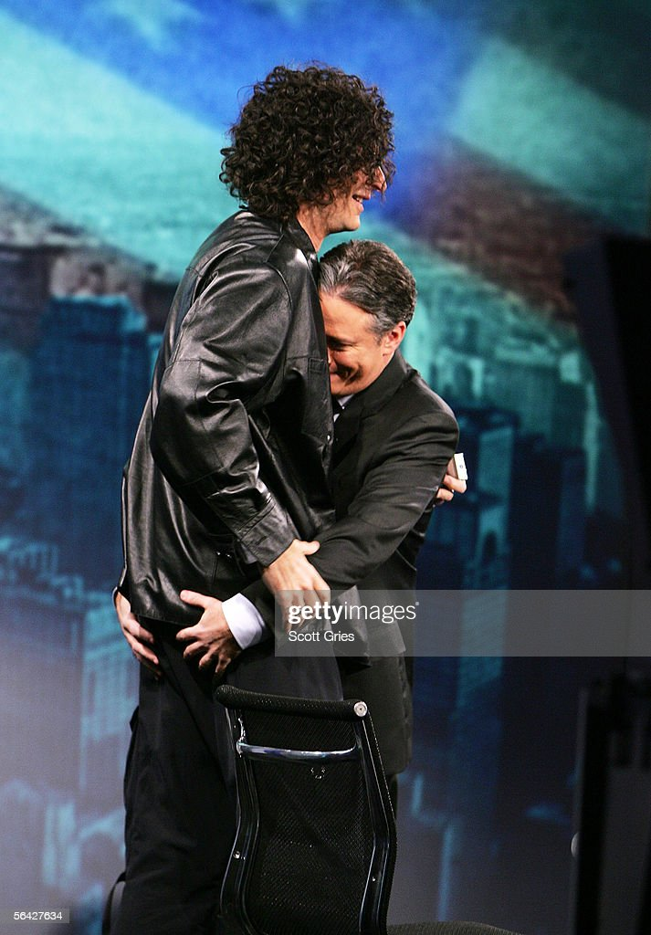 Radio personality Howard Stern dances with Jon Stewart during 'The Daily Show With Jon Stewart' at the Daily Show Studios December 13 2005 in New...