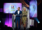 Radio personality Junior and singer Yolanda Adams present the award for ' Best Church Choir' during the 2016 Neighborhood Awards hosted by Steve...