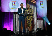 Radio personality Junior and singer Yolanda Adams speak during the 2016 Neighborhood Awards hosted by Steve Harvey at the Mandalay Bay Events Center...
