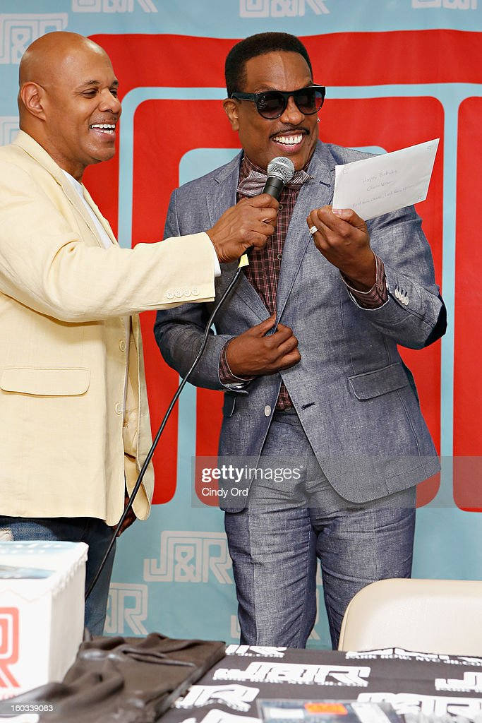 Radio personality Lenny Green interviews recording artist Charlie Wilson at J&R Music World on January 29, 2013 in New York City.