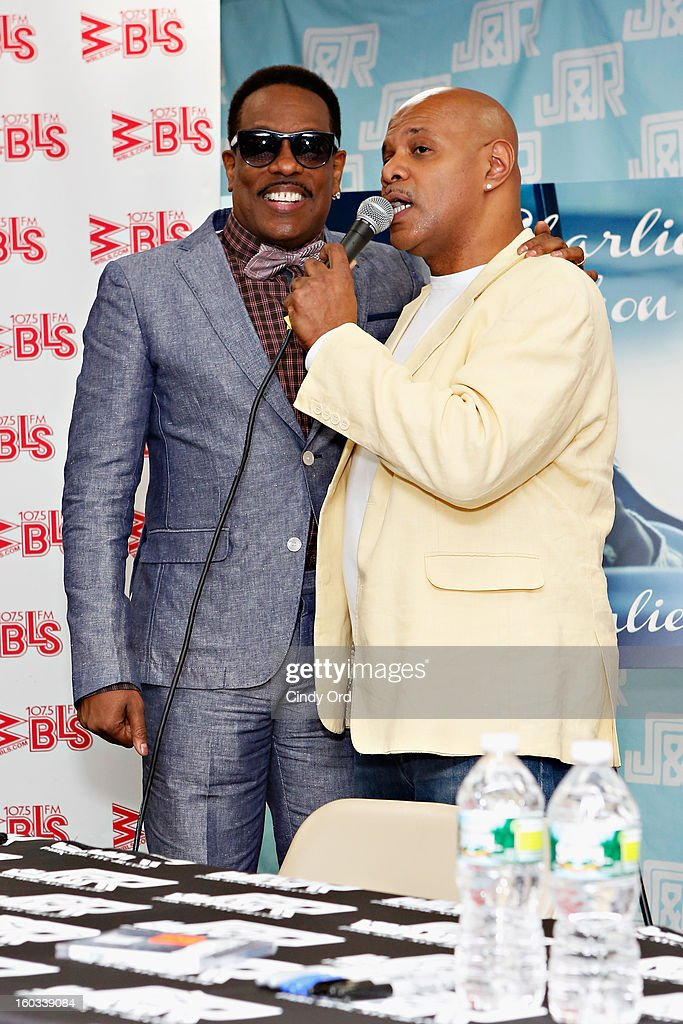 Radio personality Lenny Green (R) interviews recording artist Charlie Wilson (L) at J&R Music World on January 29, 2013 in New York City.