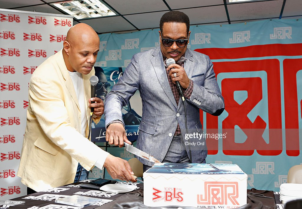 Radio personality Lenny Green presents recording artist Charlie Wilson a birthday cake at J&R Music World on January 29, 2013 in New York City.