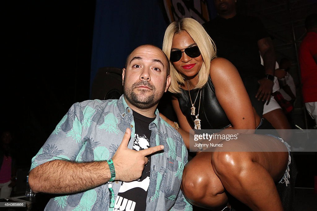 Radio personality Peter Rosenberg and recording artist Ashanti attend the On Da Reggae Tip 2014 concert event at Pier 97 on August 29 2014 in New...