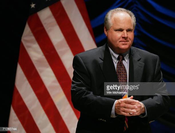 Radio personality Rush Limbaugh interacts with the audience before the start of a panel discussion ''24' and America's Image in Fighting Terrorism...