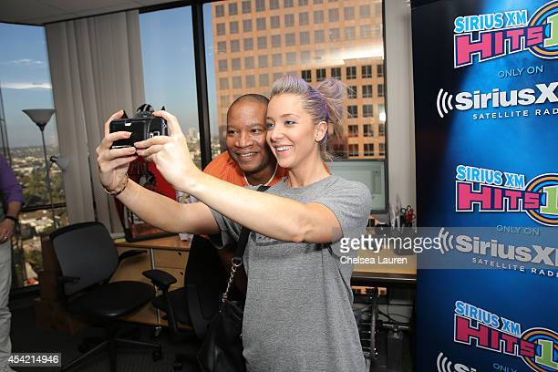 Radio personality Stanley T poses with YouTube personality Jenna Marbles at SiriusXM Hits 1's The Morning Mash Up Broadcast at SiriusXM Studios on...