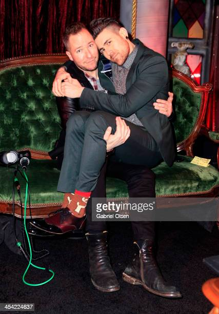 Radio personality Stryker and musician Davey Havok of AFI pose backstage during The 24th Annual KROQ Almost Acoustic Christmas at The Shrine...