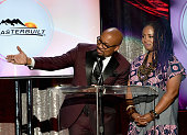 Radio personality Thomas 'Nephew Tommy' Miles and singer Lalah Hathaway speak during the 2016 Neighborhood Awards hosted by Steve Harvey at the...
