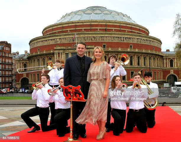 Radio presenter Kirsty Young with Opera singer Joseph Calleja and members of the National youth brass band on the steps of the Albert Memorial London...