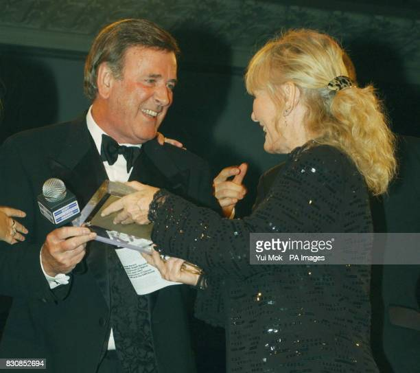 BBC Radio presenter Terry Wogan is presented with the Breakfast Music Award by Petula Clark at the Sony Radio Academy Awards at the Grosvenor House...