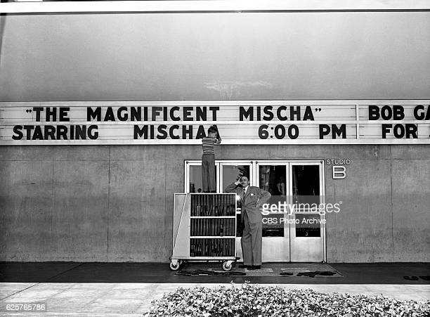 Radio program 'Mischa The Magnificent' starring Mischa Auer In this image Mischa Auers young son Tony puts up his fathers name on the CBSKNX Columbia...