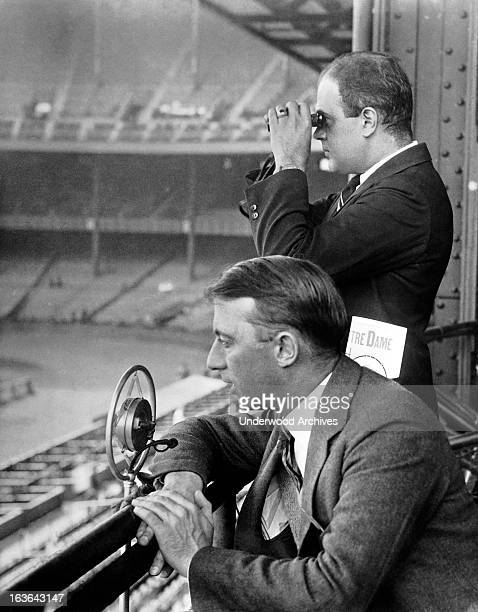 Radio sports announcers broadcasting a Notre Dame football game circa 1930