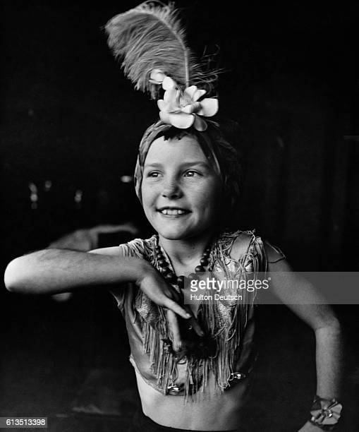 Radio star in a night English singer and actress Petula Clark rehearsing an impersonation of Brazilian film star Carmen Miranda at her home at...