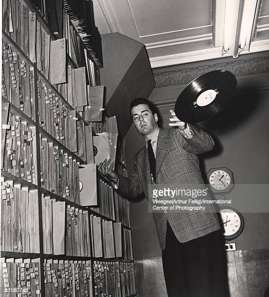WNEW radio station disc jockey Art Ford tosses a record towards the camera New York 1950s Photo by Weegee/International Center of Photography/Getty...