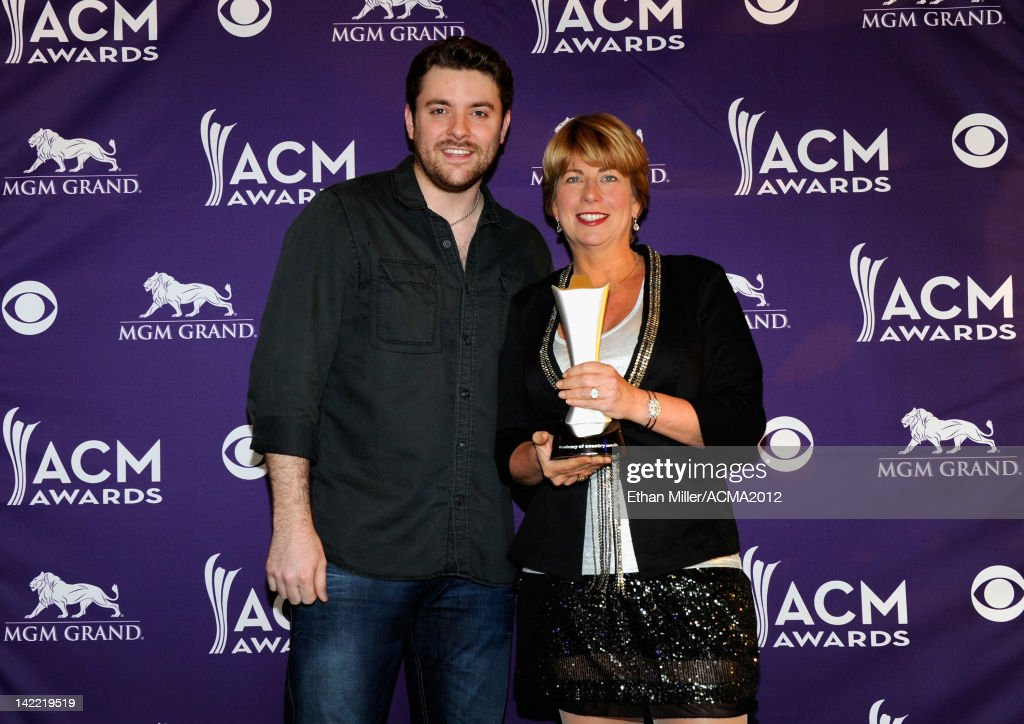 Radio Station of the Year for Large Market Winner WQDR-FM Lisa McKay (R) accepts award from Singer Chris Young onstage during ACM Radio Awards Reception at the MGM Grand Hotel/Casino on March 31, 2012 in Las Vegas, Nevada.