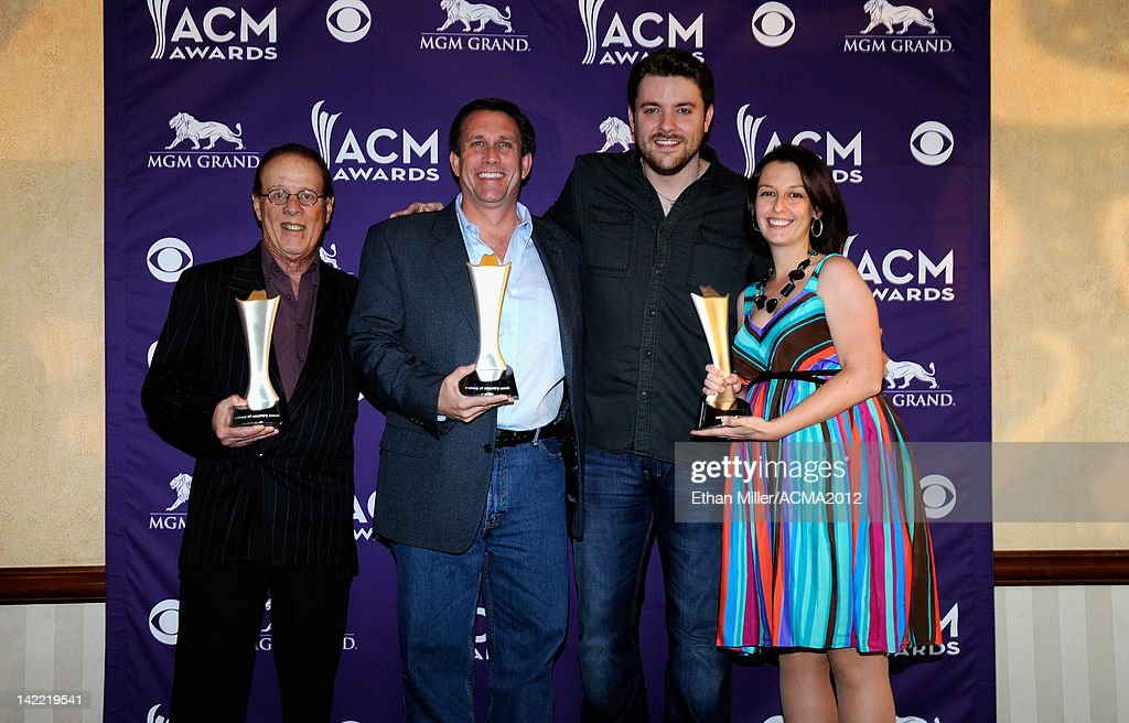 Radio Station of the Year for Major Market Winners WQYK-FM Mike Culotta, Dave McKay and Veronica Alfaro accept award from Singer Chris Young (2rdR) onstage during ACM Radio Awards Reception at the MGM Grand Hotel/Casino on March 31, 2012 in Las Vegas, Nevada.