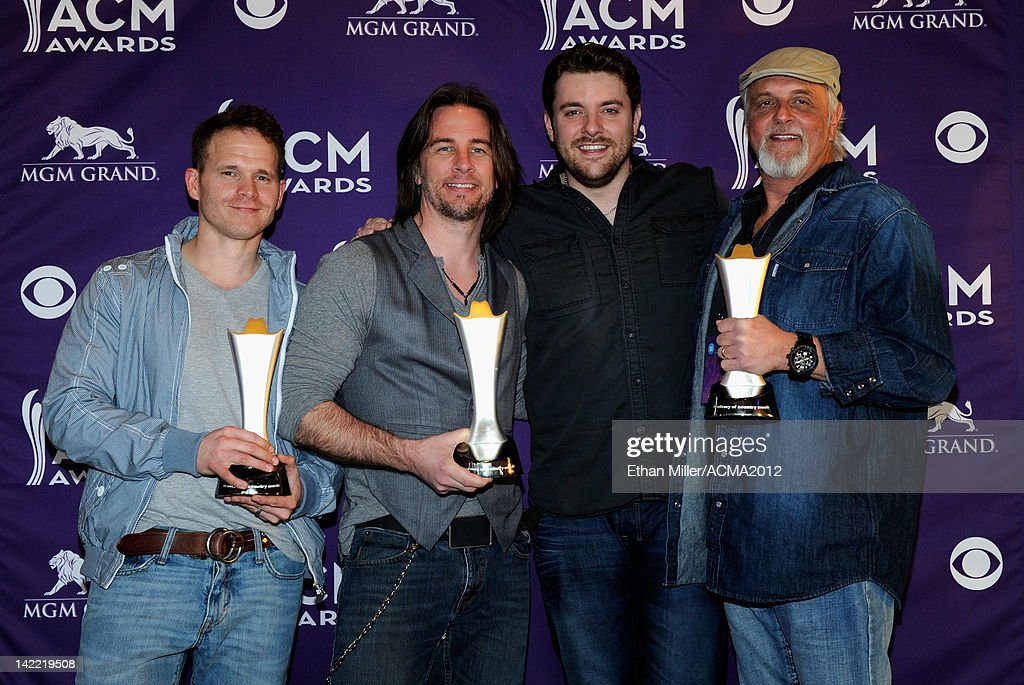 Radio Station of the Year for Small Market Winners WUSY-FM Daniel Wyatt, Gator Harrison and Benjamin Martin (R) accept award from Singer Chris Young (2ndR) onstage during ACM Radio Awards Reception at the MGM Grand Hotel/Casino on March 31, 2012 in Las Vegas, Nevada.