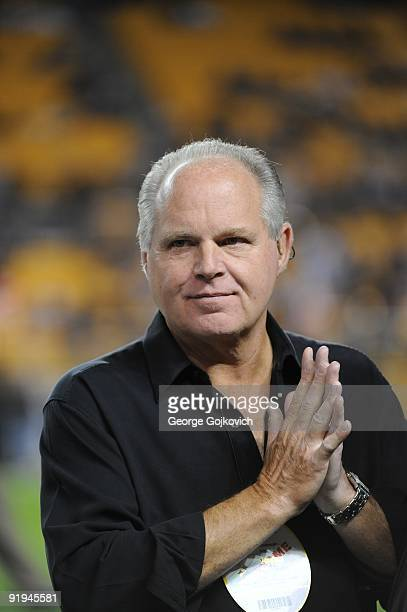 Radio talk show host and political commentator Rush Limbaugh looks on from the sideline before a National Football League game between the San Diego...