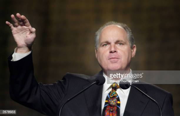 Radio talk show host Rush Limbaugh gestures as he makes remarks at the National Association of Broadcasters October 2 2003 in Philadelphia...