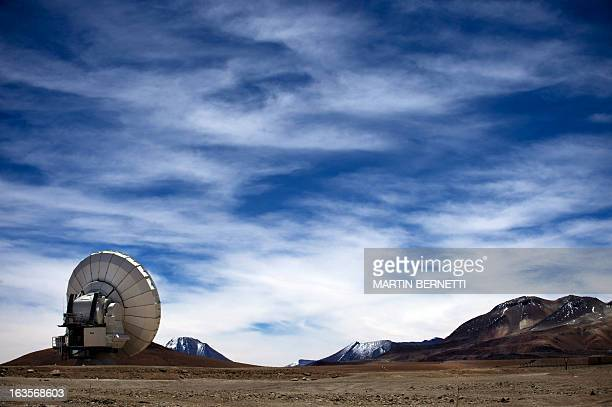 A radio telescope antenna of the ALMA project in the Chajnantor plateau Atacama desert some 1500 km north of Santiago on March 122013 The ALMA an...