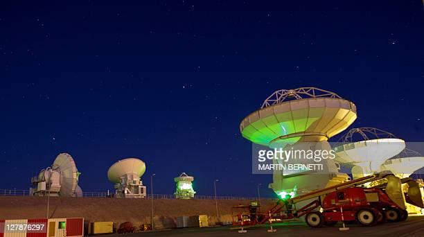Radio telescope antennas of the ALMA project in the Chajnantor plateau Atacama desert some 1500 km north of Santiago on September 30 2011 The ALMA an...