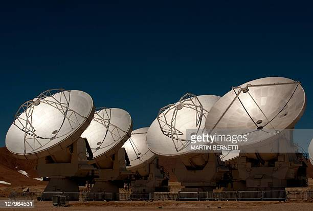 Radio telescope antennas of the ALMA project in the Chajnantor plateau Atacama desert some 1500 km north of Santiago on October 1 2011 The ALMA an...