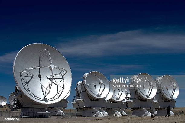 Radio telescope antennas of the ALMA project in the Chajnantor plateau Atacama desert some 1500 km north of Santiago on March 122013 The ALMA an...