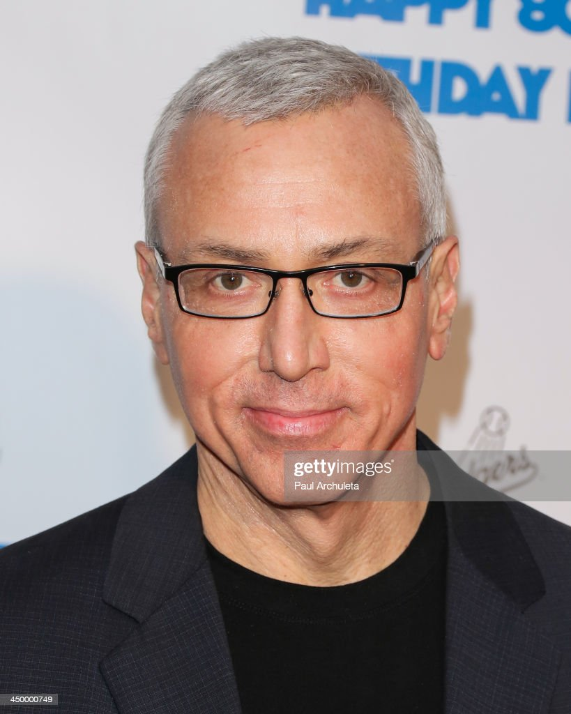 Radio / TV Personality Drew Pinsky attends a surprise party for Larry King's 80th Birthday at Dodger Stadium on November 15, 2013 in Los Angeles, California.