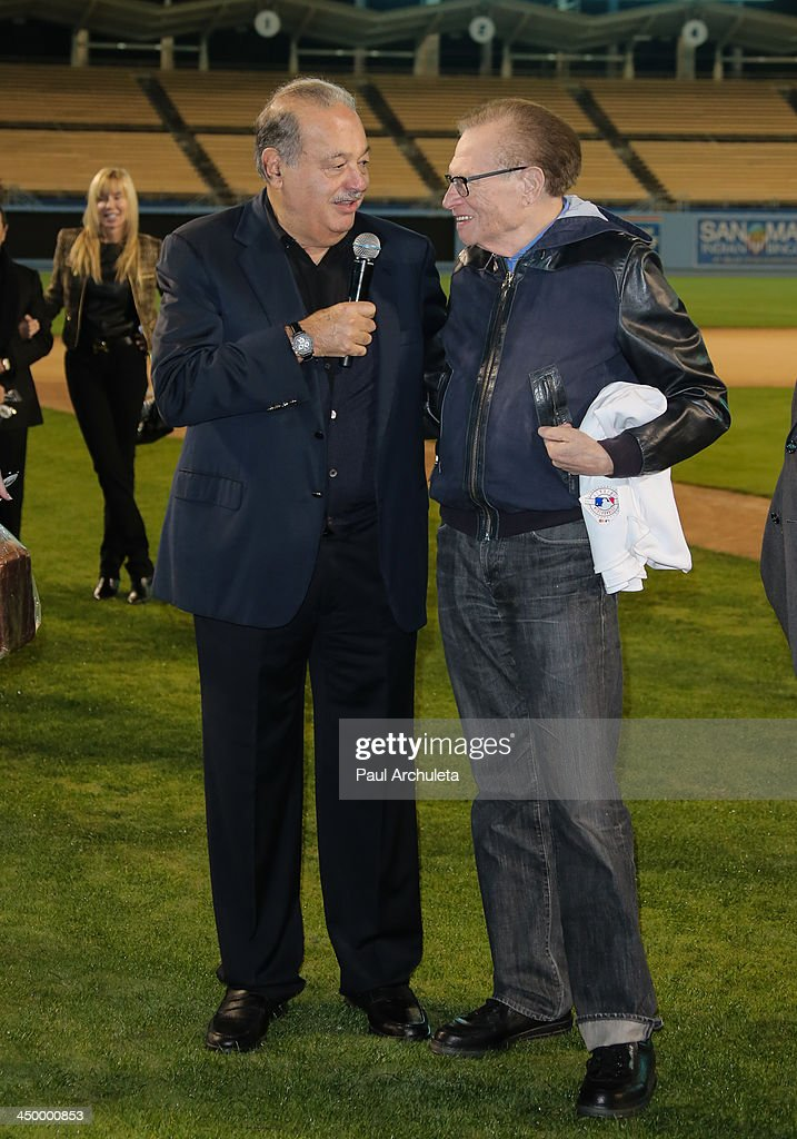 Radio / TV Personality Larry King (R) and Carlos Slim attend a surprise party for Larry King's 80th Birthday at Dodger Stadium on November 15, 2013 in Los Angeles, California.