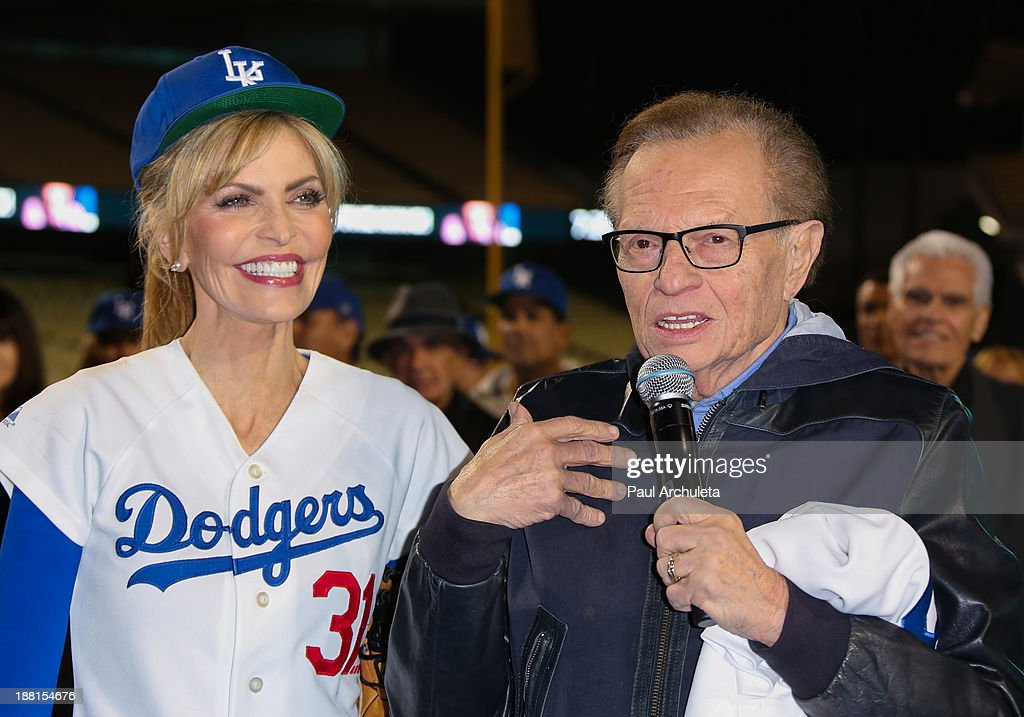 Radio / TV Personality Larry King (R) and his wife Shawn King (L) attend a surprise party for Larry King's 80th Birthday at Dodger Stadium on November 15, 2013 in Los Angeles, California.