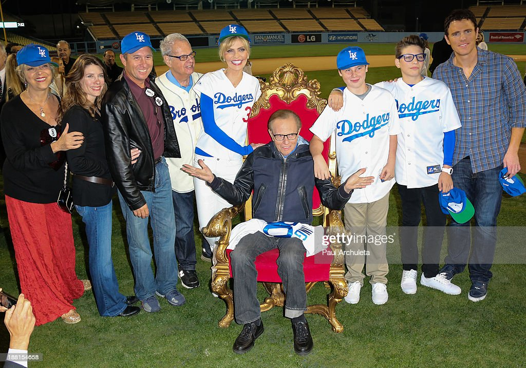 Radio / TV Personality Larry King (C) with his family attend a surprise party for his 80th Birthday at Dodger Stadium on November 15, 2013 in Los Angeles, California.