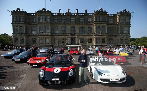 Radio Two DJ Chris Evans poses in front of Longleat House at Longleat Safari Park with a convoy of exotic cars for Children in Need's 'Drive and Dine...