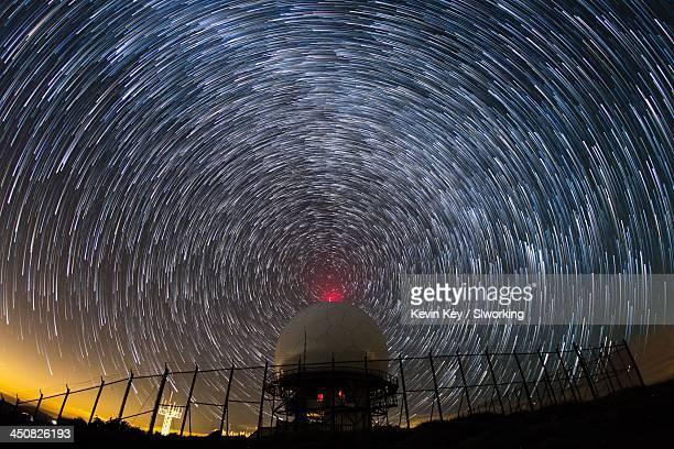 Radio waves. Star trails around radar dome