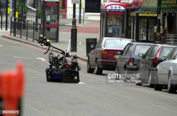 A radiocontrolled robot returns to its handlers after carrying out a controlled explosion on a suspect car in Victoria London as police are on high...