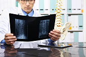 Radiologist doctor checking xray, healthcare, medical and radiology concept