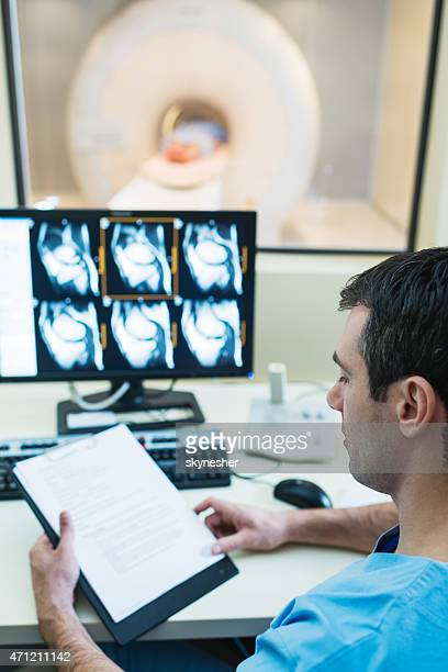 Radiologist examining results of MRI Scan.