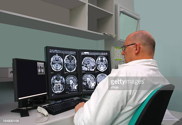 Radiologist is examing MRI scans