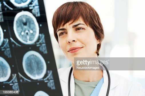 Radiologist Reviewing MRI Scan Of Brain