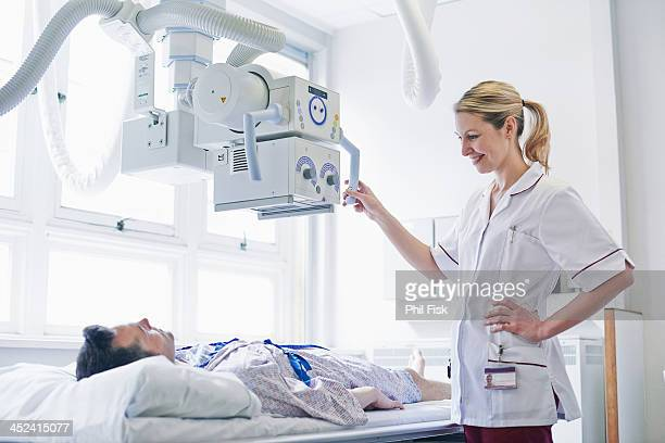 Radiologist scanning patient