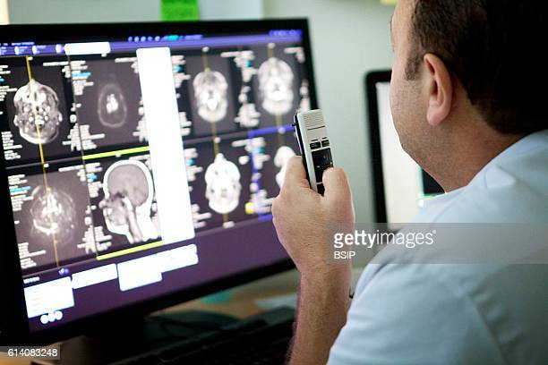 Radiology service in a hospital in HauteSavoie France A doctor interprets a patients MRI scan
