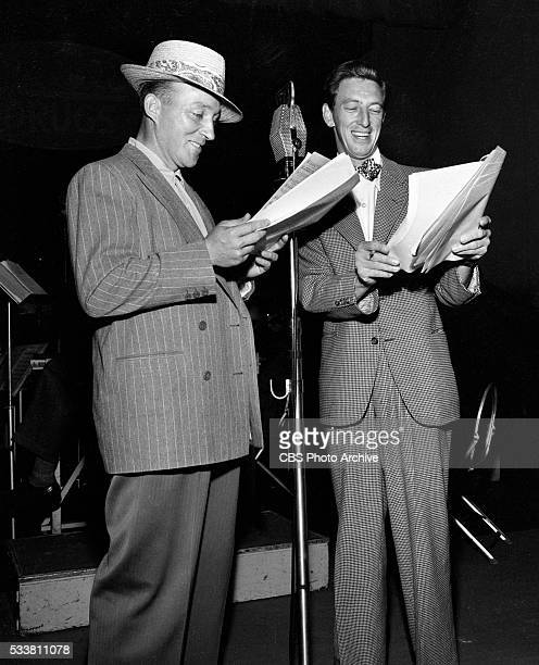 Bing Crosby and Ray Bolger during a broadcast on the first show of the summer season Image dated July 6 1945