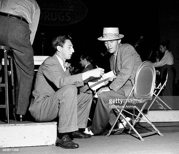 Radios Ray Bolger Show Ray Bolger goes into a script huddle with Bing Crosby just before broadcast on the first show of the summer season Image dated...