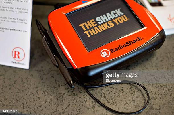 RadioShack Corp signage appears on a digital signature pad at a store in Peoria Illinois US on Tuesday July 24 2012 RadioShack Corp a...
