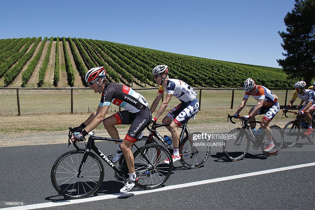 RadioShack Leopard team rider Andy Schleck (L) of Luxembourg rides during the 116.5km stage two of the Tour Down Under in Adelaide on January 23, 2013. The six-stage Tour Down Under takes place from January 20 to 27. AFP PHOTO / Mark Gunter USE